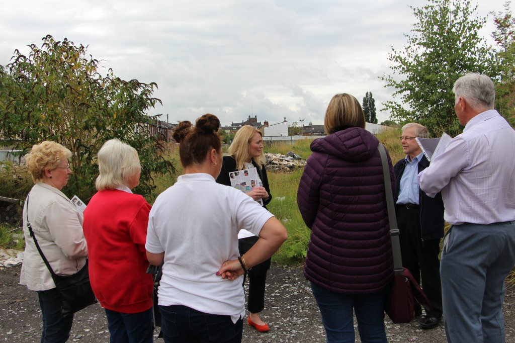Jo and members of the team discuss the site of the old rugby ground at Hilton Park, a target of anti-social behaviour and dangerous fly-tipping