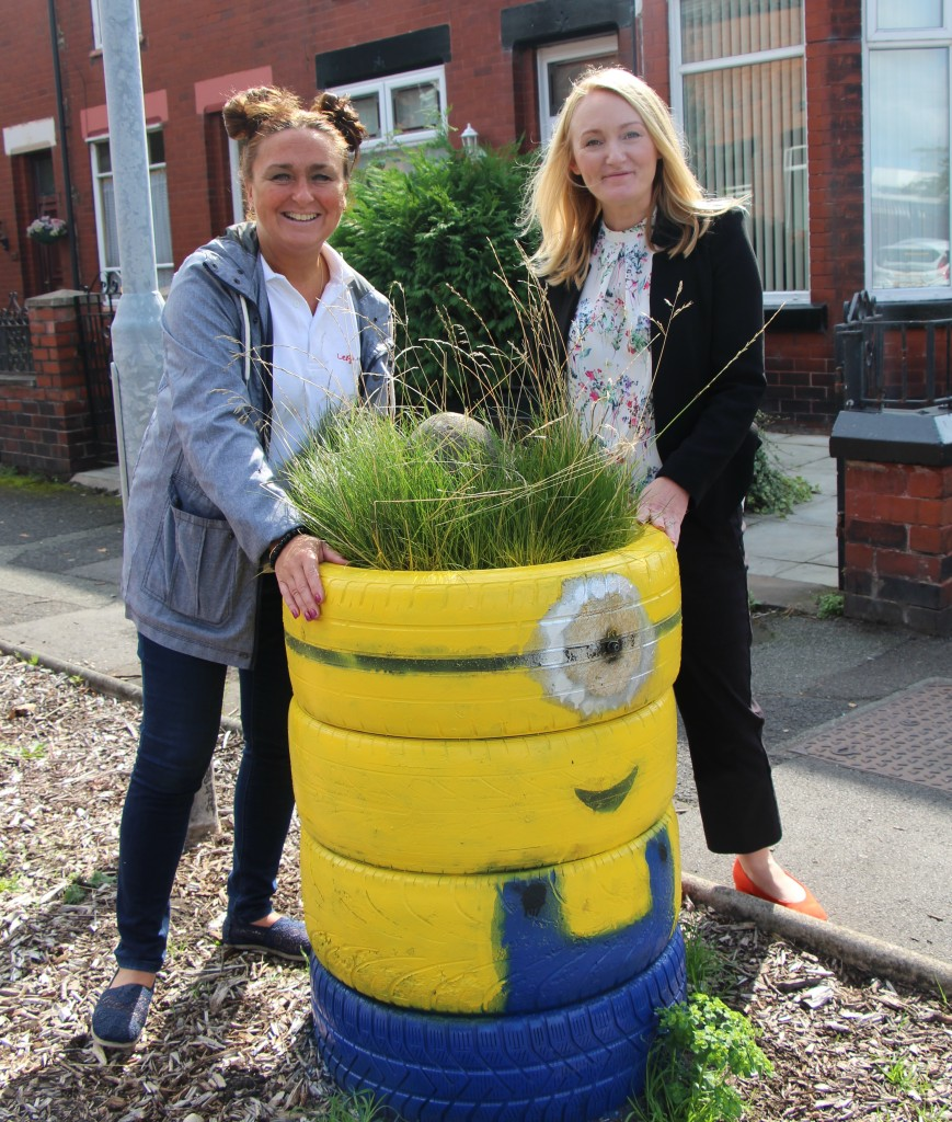 Leigh Neighbours deputy chair, Jan Eckersley, shows Jo one of her fabulous environmentally-friendly creations… a Minions-inspired planter made from recycled tyres.